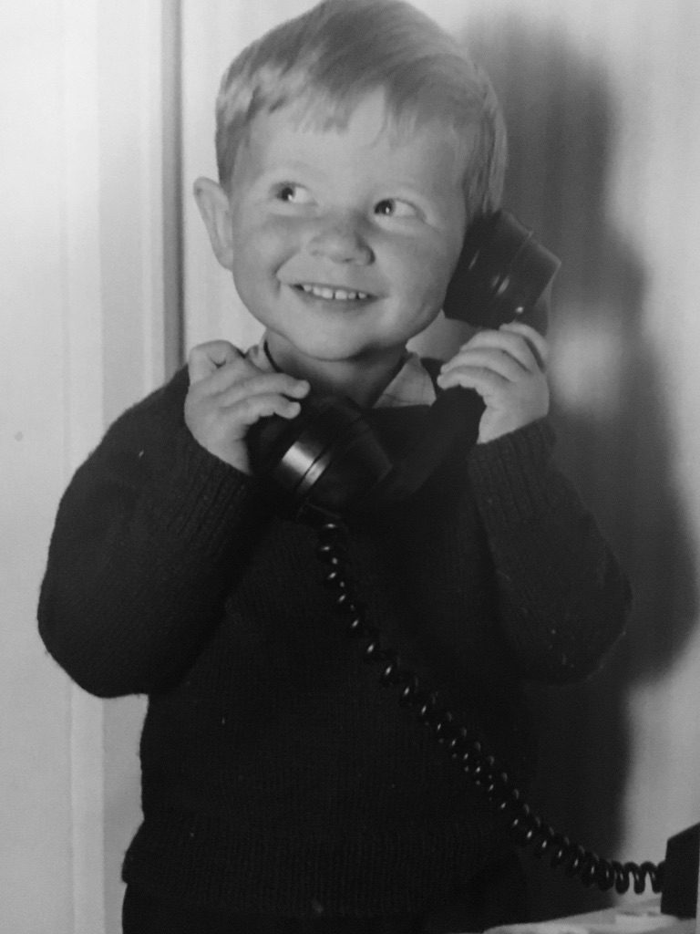 Young boy talking on old fashioned phone