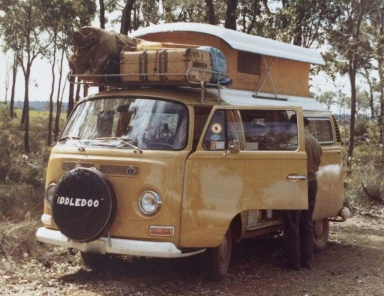Orange VW camper van loaded with luggage